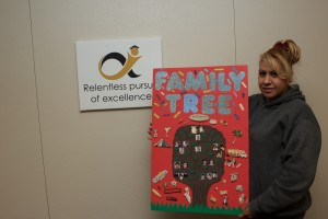 Maria Martinez shows off her Family Tree project.