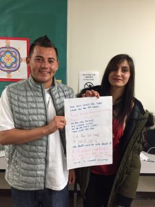 Beyza & Cesar with the poem they worked on at the poetry workshop.